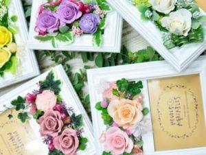 ピンクやパープルのバラを使用したプリザーブドフラワーの写真フレーム